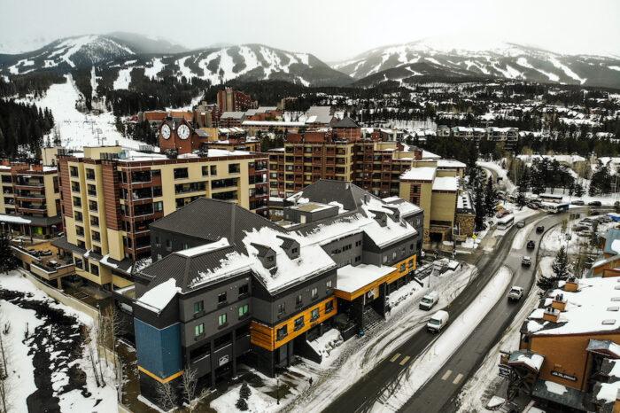 Gravity Haus Hotel with Breckenridge Ski Resort in the background during winter